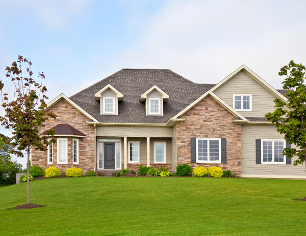 Home in Whitehouse, TX with professional lawn mowing services.